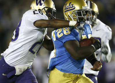 UCLA's Chris Markey  gain yardages before getting tackled by  Washington's Roy Lewis  during the first half on Saturday, September 22, 2007 at Rose Bowl. Ucla won 44-31 (Edna T. Simpson)