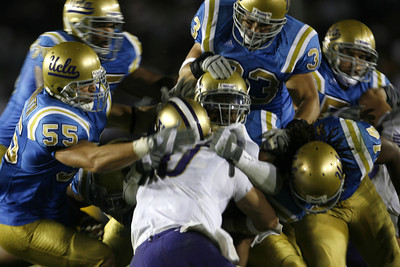UCLA's Defense players sacked Washington's QB Jake Locker in the third quarter on Saturday, September 22, 2007 at Rose Bowl. (Edna T. Simpson)