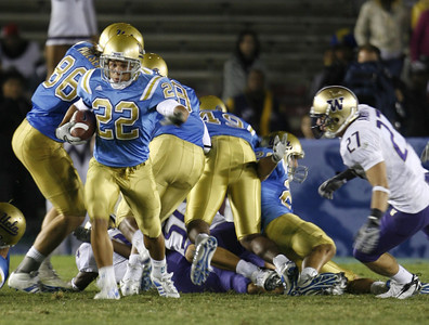UCLA's Michael Norris gains; yardage before getting tacked by Washington defense during the first half on Saturday, September 23, 2007 at Rose Bowl. (Edna T. Simpson)