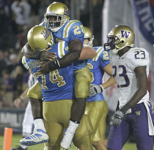 UCLA's Chris Markey celebrates with teammate Noah Sutherland after making a touchdown in fourth quarter against Washington on Saturday, September 22, 2007 at Rose Bowl.