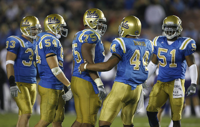 UCLA's defense players  (l-R) #33 Christian Taylor, #54 Kyle Bosworth, #75 Kevin Brown, #44 Bruce Davis and #51 Reggie Carter during the game on Saturday, September 22, 2007 against Washington. (Edna T. Simpson)