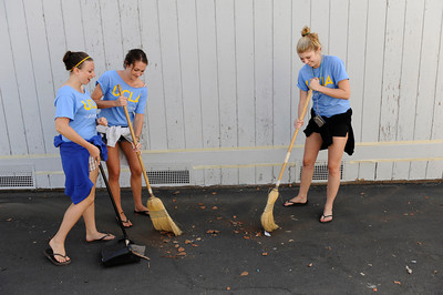 UCLA students Maddy Samuel, Kayla Friseli and Brittany Zajic sweep  at Sylvan Park Elementary School in Van Nuys. The 300 students at the school were part of the nearly 6,800 freshmen and transfer students from UCLA that were deployed to 26 locations throughout Los Angeles to do volunteer work on UCLA's third annual Volunteer Day. (Hans Gutknecht/Staff Photographer)