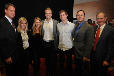 (l-r) Coach Lane Kiffin, Bev Barkley, Lainey Barkley, Batt Barkley, Sam Barkley, Les Barkley and USC Athletic Director Pat Hayden. USC Quarterback Matt Barkley announced his decision to stay in school for his Senior year rather than go into the NFL draft. The announcement was made at Heritage Hall, surrounded by Heisman Trophies, and underneath a Christmas tree. Los Angeles, CA 12/22/2011(John McCoy/Staff Photographer)