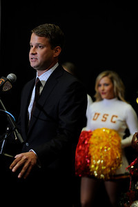 Lane Kiffin speaks after USC Quarterback Matt Barkley announced his decision to stay in school for his Senior year rather than go into the NFL draft. The announcement was made at Heritage Hall, surrounded by Heisman Trophies, and underneath a Christmas tree. Los Angeles, CA 12/22/2011(John McCoy/Staff Photographer)