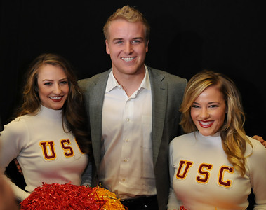 (L-r) Kaffie Rosales, Matt Barkley and Kendall Bullock. USC Quarterback Matt Barkley announced his decision to stay in school for his Senior year rather than go into the NFL draft. The announcement was made at Heritage Hall, surrounded by Heisman Trophies, and underneath a Christmas tree. Los Angeles, CA 12/22/2011(John McCoy/Staff Photographer)