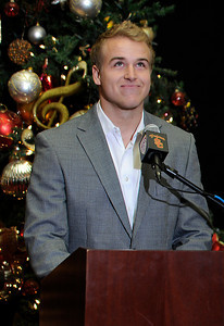 USC Quarterback Matt Barkley gets appause from his coach Lane Kiffin after he announced his decision to stay in school for his Senior year rather than go into the NFL draft. The announcement was made at Heritage Hall, surrounded by Heisman Trophies, and underneath a Christmas tree. Los Angeles, CA 12/22/2011(John McCoy/Staff Photographer)