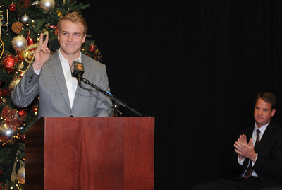 USC Quarterback Matt Barkley gets applause from his coach, Lane Kiffin, after he announced his decision to stay in school for his Senior year rather than go into the NFL draft. The announcement was made at Heritage Hall, surrounded by Heisman Trophies, and underneath a Christmas tree. Los Angeles, CA 12/22/2011(John McCoy/Staff Photographer)