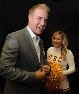 USC Quarterback Matt Barkley announced his decision to stay in school for his Senior year rather than go into the NFL draft. The announcement was made at Heritage Hall, surrounded by Heisman Trophies, and underneath a Christmas tree. Los Angeles, CA 12/22/2011(John McCoy/Staff Photographer)