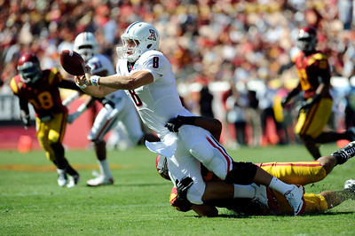 Arizona QB Nick Foles #8 is pressured USC's Wes Horton #96 in the 3rd quarter during their PAC 12 conference game at the Los Angeles Memorial Coliseum in Los Angeles, CA Saturday October 1, 2011. (Hans Gutknecht/Staff Photographer)