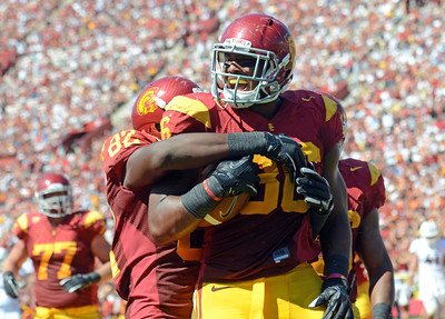 USC's Xavier Grimble #86 celebrates after hauling  in a 7-yard touchdown pass in the 2nd quarter during their PAC 12 conference game against Arizona at the Los Angeles Memorial Coliseum in Los Angeles, CA Saturday October 1, 2011. (Hans Gutknecht/Staff Photographer)