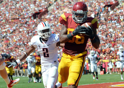 USC's Xavier Grimble #86 hauls in a 7-yard touchdown pass as Arizona's Marquis Flowers defends in the 2nd quarter during their PAC 12 conference game at the Los Angeles Memorial Coliseum in Los Angeles, CA Saturday October 1, 2011. (Hans Gutknecht/Staff Photographer)