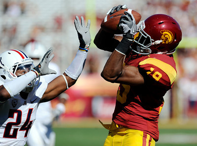 USC's Brice Butler #19 hauls in a pass as Arizona's Trevin Wade #24 defends during their PAC 12 conference game at the Los Angeles Memorial Coliseum in Los Angeles, CA Saturday October 1, 2011. USC beat Arizona 48-41. (Hans Gutknecht/Staff Photographer)