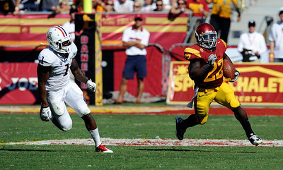 USC's Curtis McNeal #22 runs for a big gain as Arizona's Robert Golden #1 pursues in the 4th quarter during their PAC 12 conference game at the Los Angeles Memorial Coliseum in Los Angeles, CA Saturday October 1, 2011. USC beat Arizona 48-41. (Hans Gutknecht/Staff Photographer)