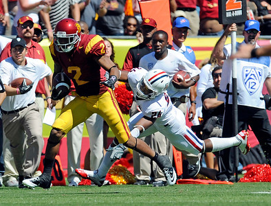 USC's Robert Woods #2 shakes off the tackle of Trevon Wade #24 on his way to the end zone for a for a 82-yard touchdown during their PAC 12 conference game at the Los Angeles Memorial Coliseum in Los Angeles, CA Saturday October 1, 2011. (Hans Gutknecht/Staff Photographer)