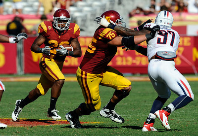 USC's Marcus Tyler looks for some running room during their PAC 12 conference game against Arizona at the Los Angeles Memorial Coliseum in Los Angeles, CA Saturday October 1, 2011. USC beat Arizona 48-41. (Hans Gutknecht/Staff Photographer)