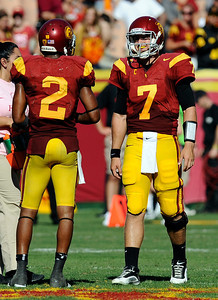 USC quarterback  Matt Barkley #7 smiles at receiver Robert Woods #2 in the final seconds of their  PAC 12 conference game against Arizona at the Los Angeles Memorial Coliseum in Los Angeles, CA Saturday October 1, 2011. USC beat Arizona 48-41.(Hans Gutknecht/Staff Photographer)