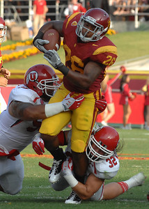 Trojans running back Marc Tyler gets short yardage in the first quarter. USC hosted the Utah Utes in a game played at the Coliseum in Los Angeles CA. 9-10-2011. (John McCoy/Staff Photographer)