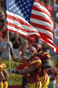 Trojans Robert Woods carries the American Flag out onto the field before kickoff. USC hosted the Utah Utes in a game played at the Coliseum in Los Angeles CA. 9-10-2011. (John McCoy/Staff Photographer)
