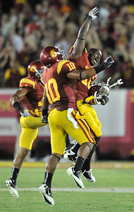USC player celebrate in the 4th quarter when they thought they held Utah short on a 4th down play that would have ended the game. The spot of the ball was changed, Utah then tried for a field goal, and had it blocked to end the game. USC defeated the Utah Utes 23 to 14 in a game played at the Coliseum in Los Angeles CA. 9-10-2011. (John McCoy/Staff Photographer)