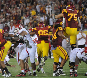 USC blocks a last second field goal attempt by Utah to win the game. USC defeated the Utah Utes 23   to 14 in a game played at the Coliseum in Los Angeles CA. 9-10-2011. (John McCoy/Staff Photographer)