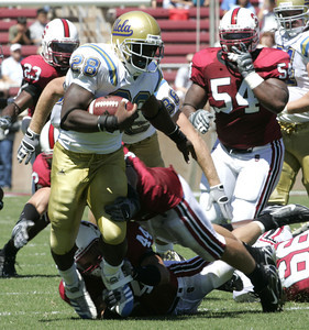 Ucla Chris Markey gains yardage before getting tackle by Stanford Pat Maynor during the first half on Saturday. September 1st, 2007 at Stanford Stadium. Ucla won 45-17 (Edna  T. Simpson)