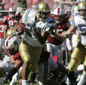 Ucla Christian Ramirez breaks away from Stanford defense enroute for a touchdown during the fourth quarter on Saturday, September 1st, 2007  (Edna T. Simpson)