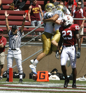 Ucla Joe Cowan celebrates with his teammate Logan Paulsen after making the first touchdown of the game during the first quarter on Saturday, September 1st, 2007 at Stanford Stadium. Ucla won 45-17 (Edna T. Simpson)