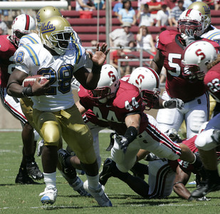 Ucla Chris Markey escapes Stanford defense players during the first quarter of the vicory game on Saturday, September 1st, 2007 (Edna T. Simpson)