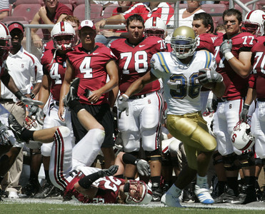 Ucla Kahill Bell breaks away from Stanford Bo McNally  during the first half of the victory game on Saturday, September 1st, 2007 at Stanford Stadium. Ucla won  45-17 (Edna T. Simpson)