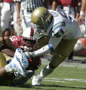 Ucla Reggie Carter makes a tackle of Stanford Jason Evans during the game on Saturday, September 1st, 2007 (Edna T. Simpson)