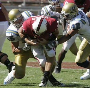 Ucla Korey Bosworth and Aaron Whittington sack Stanford QB T.C.  Ostrander during the third quarter on Saturday, September 1st, 2007 at Stanford. (Edna T. Simpson)