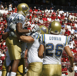 Ucla Dominique Johnson #19 celebrates with teammates after making a touchdown in the third quarter of the victory game on Saturday, September 1st, 2007 at Stanford Stadium. Ucla won 45-17 (Edna T. Simpson)