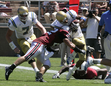 Ucla Terrence Austin gets tackle by Stanford Bo Bo McNally during the first half of the victory game on Saturday, September 1st, 2007  (Edna T. Simpson)