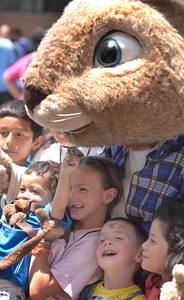 "Several kids pose with E.B. star of ""Hop.""  A 3,000 Pound Holiday Feast Brought Early Holiday Cheer to 1,000 L.A. Area Shelter Families as Universal Studios Hollywood Rang In Its  20th Annual ÒChristmas in SpringÓ Event at M.E.N.D. Transitional Living Center in Van Nuys.  Ten Area Family Shelters in, Hollywood, North Hollywood, East L.A. and Pasadena Facilities Enjoy Festivities with Holiday Feast,  Visit from E.B., Star of ÒHop,Ó  Santa Claus and Scores of Universal Volunteers  2,000 pounds of chicken, 500 pounds of mashed potatoes, 600 pounds of vegetables, 20 gallons of gravy and 6,000 hand-made desserts were served to 1,000 transitional-living family shelter residents during Universal Studios HollywoodÕs 20th annual ÒChristmas in SpringÓ celebration.  For the past 20 years, Universal Studios HollywoodÕs philanthropic ÒDiscover A Star FoundationÓ has helped L.A. Family Housing spread early holiday cheer during this non-traditional time of year when many of the needs of less-affluent families are often overlooked.    E.B., the star of Universal PicturesÕ hit movie, ÒHopÓ Santa Claus, joined Universal Studios Hollywood employee volunteers to bring joy to families and children from M.E.N.D. and those bused in from 10 area transitional living facilities, including P.A.T.H. (People Assisting the Homeless) in Hollywood, L.A. Family HousingÔs North Hollywood Valley Shelter, East L.A.Õs Triangle House, Comunidad Cesar Chavez, Vineland Place in North Hollywood, the Downtown WomenÕs Center in Los Angeles and the Union Station Homeless Services in Pasadena. Dean Musgrove/Staff Photographer"
