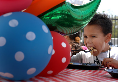 Seven year-old Josiah Carillo, from North Hollywood, enjoyed the food.  A 3,000 Pound Holiday Feast Brought Early Holiday Cheer to 1,000 L.A. Area Shelter Families as Universal Studios Hollywood Rang In Its  20th Annual ÒChristmas in SpringÓ Event at M.E.N.D. Transitional Living Center in Van Nuys.  Ten Area Family Shelters in, Hollywood, North Hollywood, East L.A. and Pasadena Facilities Enjoy Festivities with Holiday Feast,  Visit from E.B., Star of ÒHop,Ó  Santa Claus and Scores of Universal Volunteers  2,000 pounds of chicken, 500 pounds of mashed potatoes, 600 pounds of vegetables, 20 gallons of gravy and 6,000 hand-made desserts were served to 1,000 transitional-living family shelter residents during Universal Studios HollywoodÕs 20th annual ÒChristmas in SpringÓ celebration.  For the past 20 years, Universal Studios HollywoodÕs philanthropic ÒDiscover A Star FoundationÓ has helped L.A. Family Housing spread early holiday cheer during this non-traditional time of year when many of the needs of less-affluent families are often overlooked.    E.B., the star of Universal PicturesÕ hit movie, ÒHopÓ Santa Claus, joined Universal Studios Hollywood employee volunteers to bring joy to families and children from M.E.N.D. and those bused in from 10 area transitional living facilities, including P.A.T.H. (People Assisting the Homeless) in Hollywood, L.A. Family HousingÔs North Hollywood Valley Shelter, East L.A.Õs Triangle House, Comunidad Cesar Chavez, Vineland Place in North Hollywood, the Downtown WomenÕs Center in Los Angeles and the Union Station Homeless Services in Pasadena. Dean Musgrove/Staff Photographer