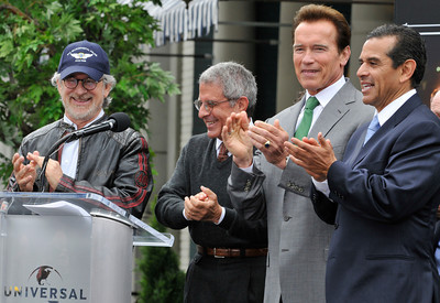 (l-r) Steven Spielberg, Ron Meyer, Governor Arnold Schwarzenegger and Mayor Antonio Villaraigosa applaud the firefigters at the conclusion of the unveiling ceremony. Universal Studios Hollywood re-opened its backlot that was rebuilt after an extensive fire burned much of it to the ground in June of 2008. Universal City, CA. 5/27/2010. photo by John McCoy/staff photographer