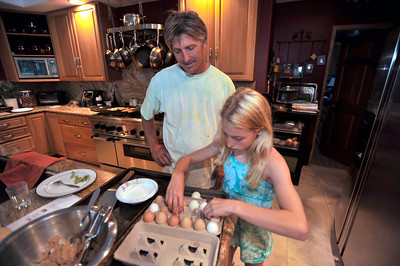 Robert Childers and his daughter Tori,11, sort through some eggs. The Childers family has four chickens in thier backyard that provide them with entertainment, and fresh eggs. Northridge, Ca 7-19-2011. (John McCoy/Staff Photographer)