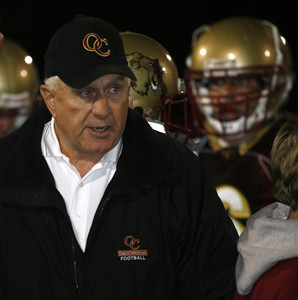 Oaks Christian's Head Coach Bill Redell talks with his team during a break in the first half on Friday, September 28, 2007 against Venice High School. (Edna T. Simpson)
