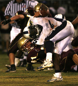 Venice's Curtis McNeal gets tackled by Oaks Christian's   Ruben Ocon during the fourth quarter on Friday, September 28, 2007 at Oaks Christian High School. (Edna T. Simpson)