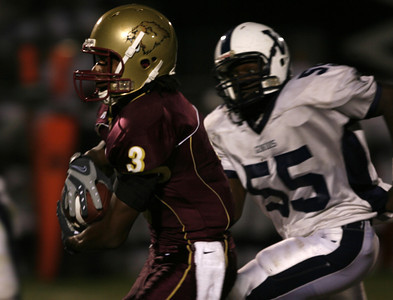 Oaks Christian's Jason  Miguel gains yardage in front of Venice's Jordan Winters during the first half on Friday, September 27, 2007. (Edna T. Simpson)