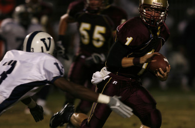 Oaks Christian's Christopher  Potter breaks away from Venice J.R. McConico during the first half on Friday, September 28, 2007. (Edna T. Simpson)