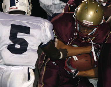 Oaks Christian's Ryan Landseadel tries to get away from Venice's Curtis McNeal during the game on Friday, September 28, 2007 at Oaks Christian High School. (Edna T. Simpson)