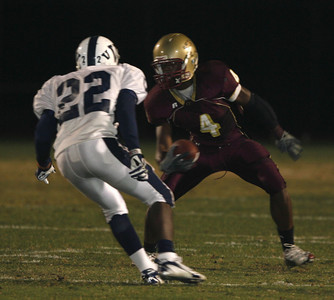 Oaks Christian's Christopher Owusu tries to get past Venice's Kris Johnson during the game on Friday, September 28, 2007 at Oaks Christian High School. (Edna T. Simpson)