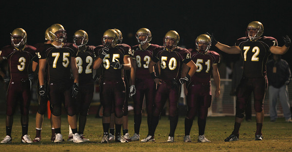 Oaks Christian's players stands on the the field during a timeout on Friday, September 28, 2007 against Venice. (Edna T. Simpson)