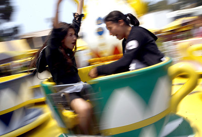 "Tea cups. 13-year-old Haley Galvan (left) and her friend 14-year-old Marcela Felix both from Santa Paula, enjoy the tea cup ride at the Ventura County Fair in Ventura, CA. August 4, 2007. ""I got really dizzy and could not see anything, "" said Galvan. (Ernesto Elizarraraz, Special to the Daily News)"