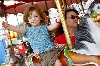 Classic attraction. 4-year-old Kaitlin Dahl from Simi Valley and her mother Dawn Dahl, ride the classic carousel during the Ventura County Fair in Ventura, CA. August 4, 2007. Kaitlin's parents have been bringing her to the fair for the last three years. (Ernesto Elizarraraz, Special to the Daily News)