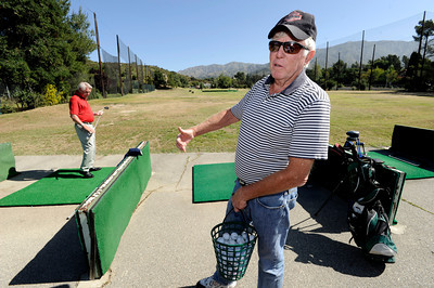 Dick Saatzer, left, and Darrel McHenry on the driving range at Verdugo. Discussions are being held with various government entities about the possibility of purchasing the Verdugo Hills Golf Course in Tujunga and the Weddington Golf Course in Studio City, by using potential revenue from bonds, or other funding. Tujunga, CA 5-27-2011. (John McCoy/Staff Photographer)