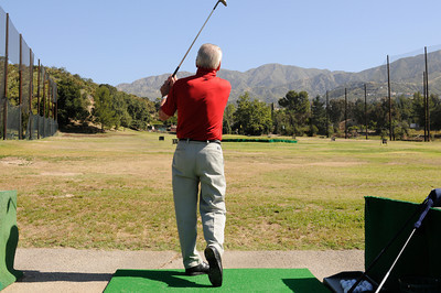 Dick Saatzer on looks toward the San Gabriel Mountains while on the driving range. Discussions are being held with various government entities about the possibility of purchasing the Verdugo Hills Golf Course in Tujunga and the Weddington Golf Course in Studio City, by using potential revenue from bonds, or other funding. Tujunga, CA 5-27-2011. (John McCoy/Staff Photographer)