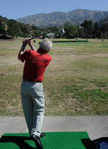 Dick Saatzer was a former Manager of the Verdugo Hills Golf Course, now he spends a lot of time playing and practicing on the driving range. The city is negotiating to buy the Verdugo Hills Golf Course in Tujunga and the Weddington Golf Course in Studio City, using revenue from Proposition O.Tujunga, CA 5-27-2011. (John McCoy/Staff Photographer)