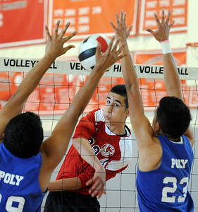 Verdugo's Araz Stepanian (33) hits the ball as Poly's Luis Garcia (29) and Xavier Montalvan (23) defend during their boys volleyball match at Verdugo Hills High School in Tujunga Monday, April 9, 2012. (Hans Gutknecht/Staff Photographer)